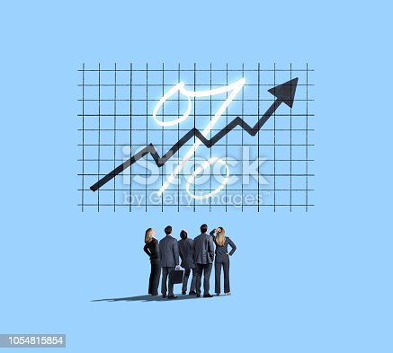 A group of business people look up at a chart that shows rising interest rates isolated against a blue background.