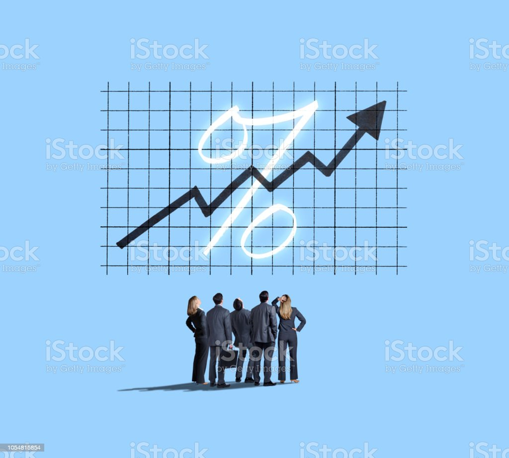Group Of Business People Look Up At Rising Interest Rates stock photo