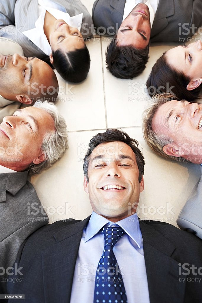 Group of business people lying on the floor royalty-free stock photo