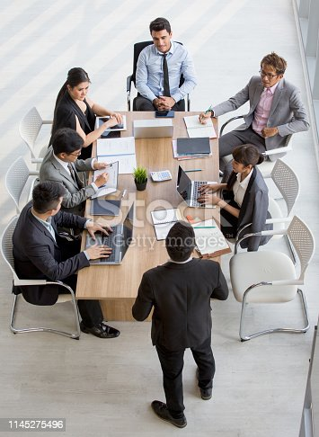 Group of business People Meeting Conference in office . marketing team Brainstorming Teamwork together at workspace.Discussion Corporate coworkers discussing Financial . multi-ethnic. High angle view