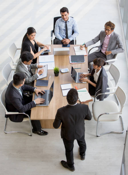 Group of business People Meeting Conference in office . marketing team Brainstorming Teamwork together at workspace.Discussion Corporate coworkers discussing Financial . multi-ethnic. High angle view stock photo