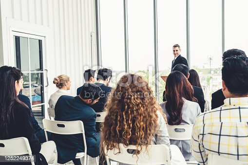 1031237974 istock photo Group of business people meeting in a seminar conference 1252249374