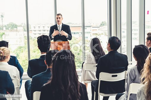 1031237974 istock photo Group of business people meeting in a seminar conference 1252249388