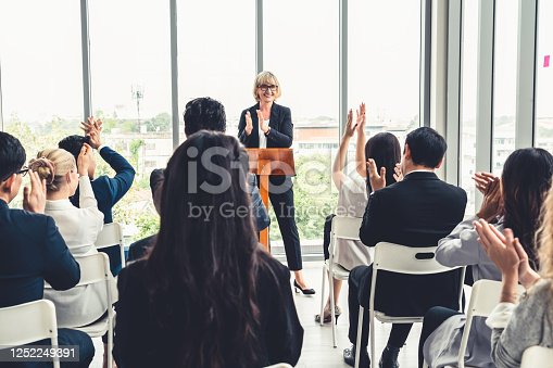 1031237974 istock photo Group of business people meeting in a seminar conference 1252249391