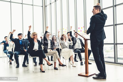 1031237974 istock photo Group of business people meeting in a seminar conference 1252249394