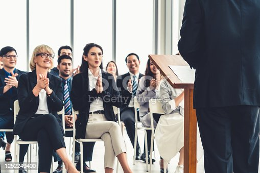 1031237974 istock photo Group of business people meeting in a seminar conference 1252249400