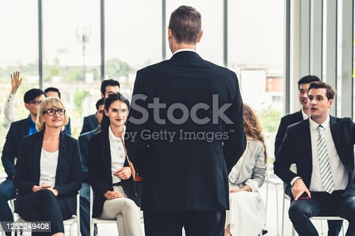 1031237974 istock photo Group of business people meeting in a seminar conference 1252249408