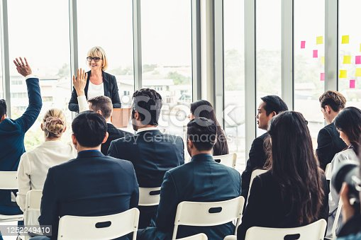 1031237974 istock photo Group of business people meeting in a seminar conference 1252249410
