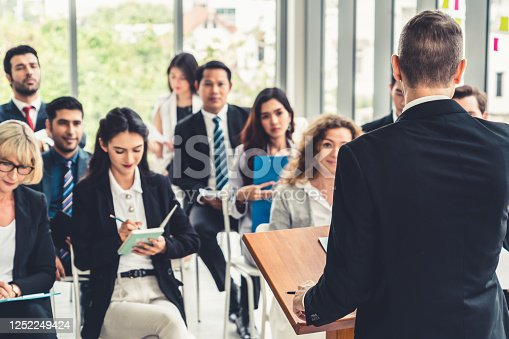 1031237974 istock photo Group of business people meeting in a seminar conference 1252249424