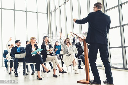 1031237974 istock photo Group of business people meeting in a seminar conference 1252249425