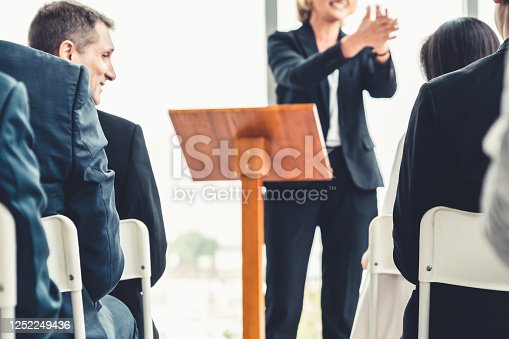 1031237974 istock photo Group of business people meeting in a seminar conference 1252249436