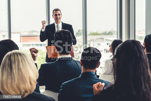 1031237974 istock photo Group of business people meeting in a seminar conference 1252249449