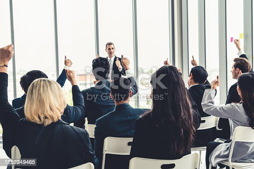 1031237974 istock photo Group of business people meeting in a seminar conference 1252249465
