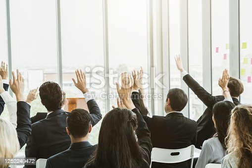 1031237974 istock photo Group of business people meeting in a seminar conference 1252249472