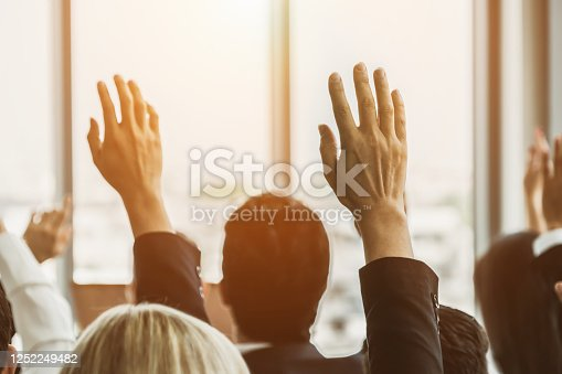 1031237974 istock photo Group of business people meeting in a seminar conference 1252249482