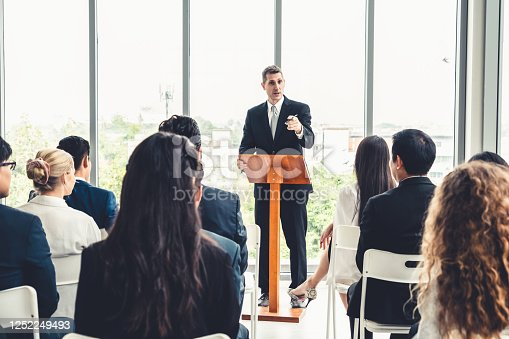 1031237974 istock photo Group of business people meeting in a seminar conference 1252249493