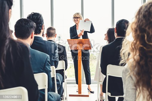 1031237974 istock photo Group of business people meeting in a seminar conference 1252249511