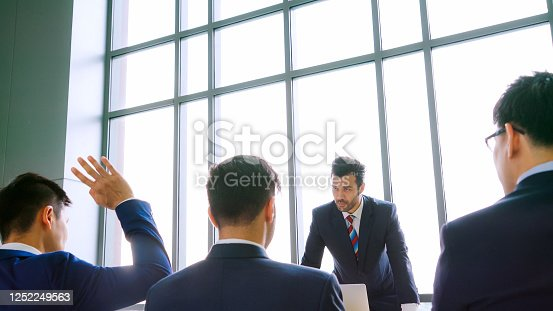 1031237974 istock photo Group of business people meeting in a seminar conference 1252249563