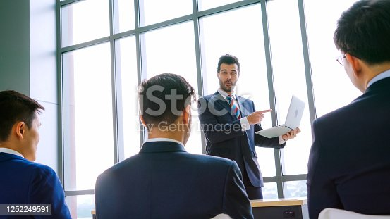1031237974 istock photo Group of business people meeting in a seminar conference 1252249591