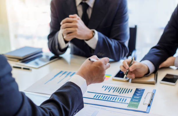 Group of business people meeting to discuss financial investment and marketing. Group of business people meeting to discuss financial investment and marketing. obedience stock pictures, royalty-free photos & images