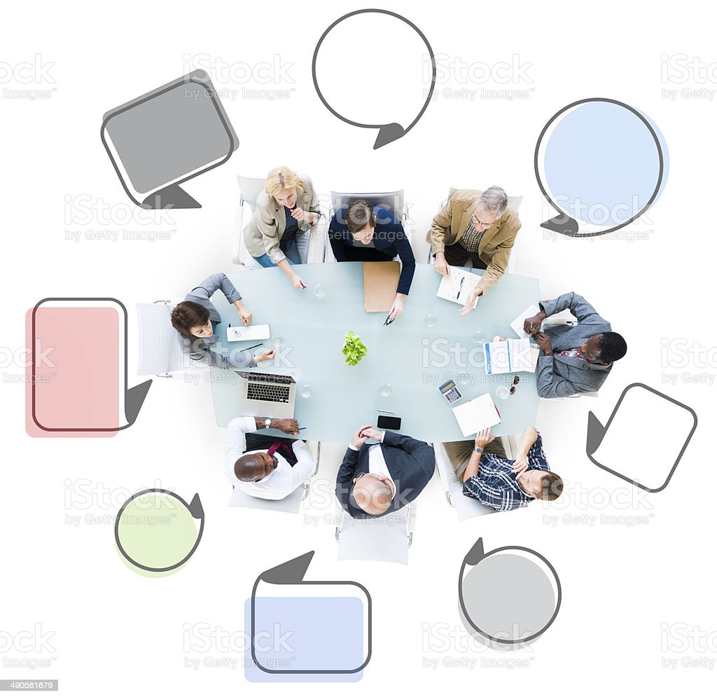 Group of Business People Meeting with Speech Bubbles stock photo