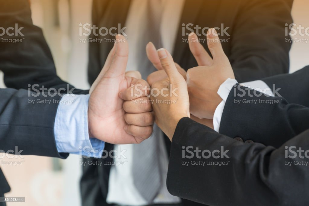 Group of business people meeting with thumb up gesture.Teamwork concept royalty-free stock photo