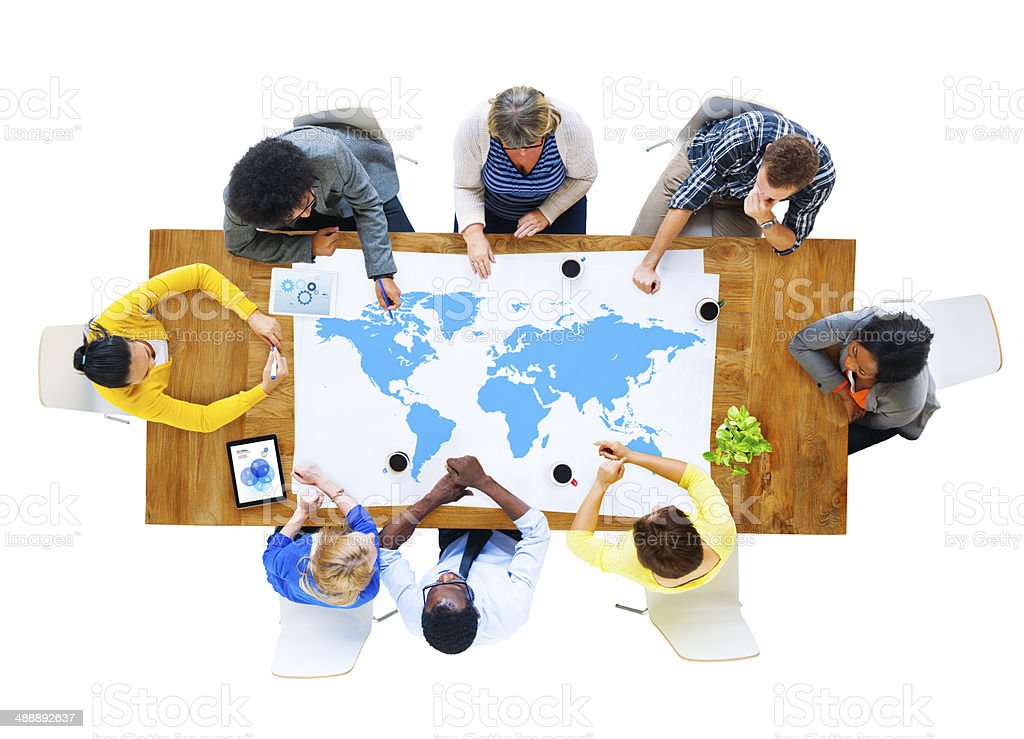 Group of Business People Meeting with World Map stock photo