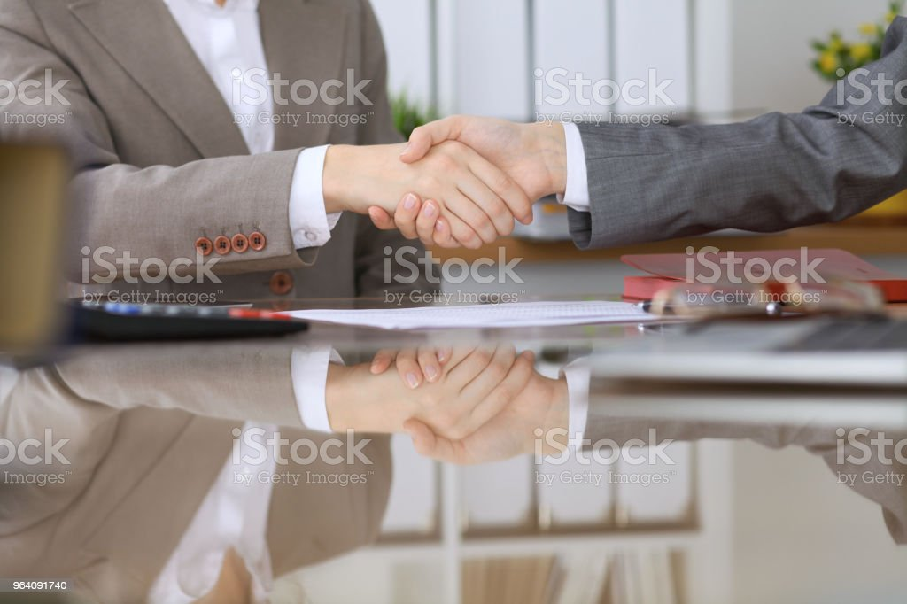 Group of business people or lawyers at meeting  shaking hands, close-u - Royalty-free Adult Stock Photo