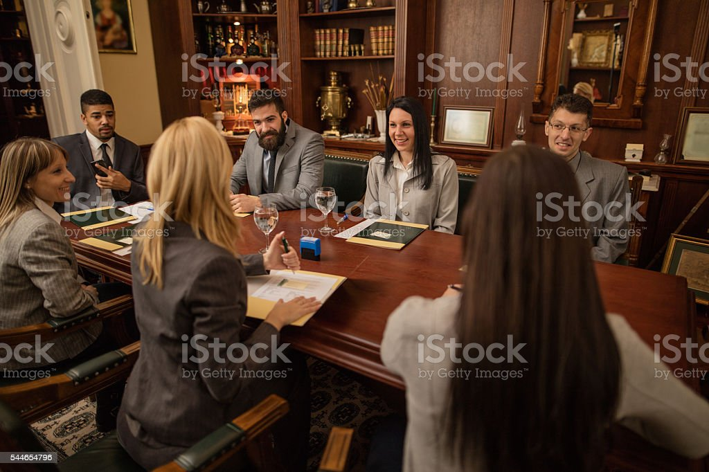 group of business people or lawyers - meeting in office stock photo