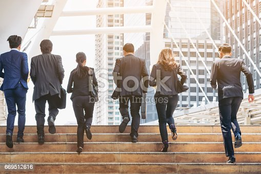 istock Group of Business People Running in Row 669512616