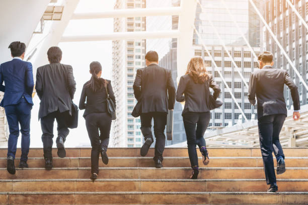 group of business people running in row - number 6 stock photos and pictures