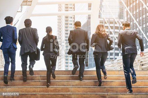 istock Group of Business People Running in Row 840334370