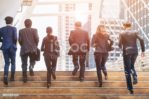 istock Group of Business People Running in Row 860068400
