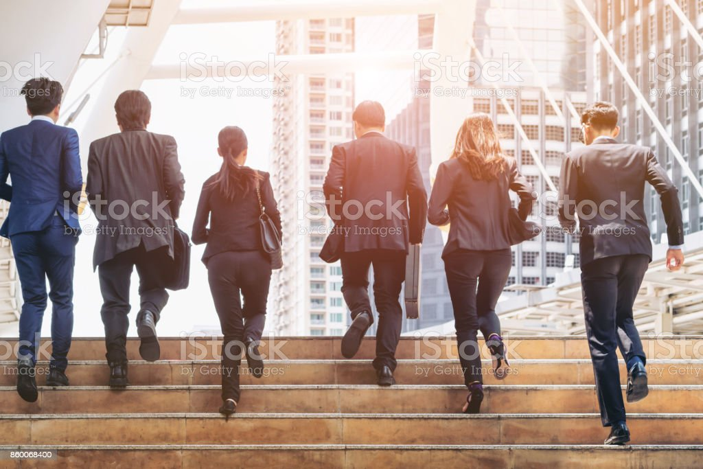 Group of Business People Running in Row stock photo
