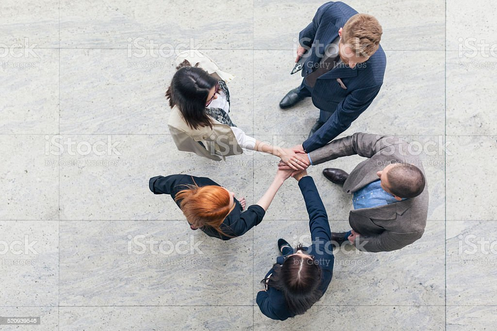 Group of business people shaking hands stock photo
