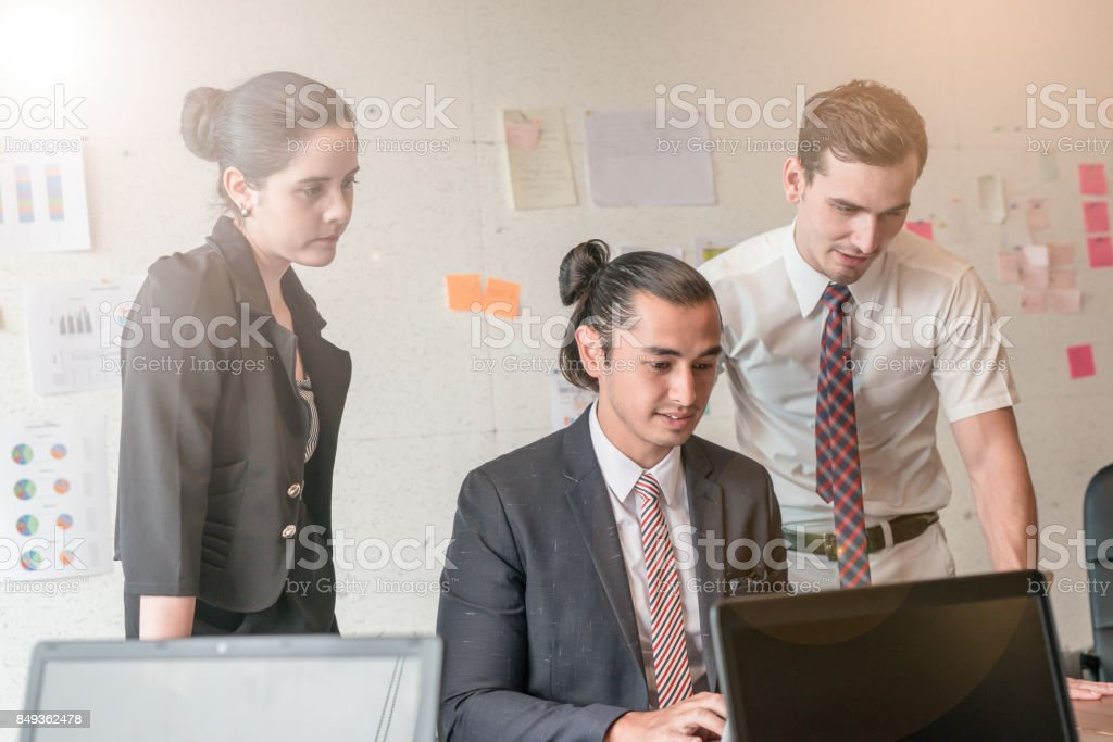 Group Of Business People Sharing Their Ideas In Office Stock Photo
