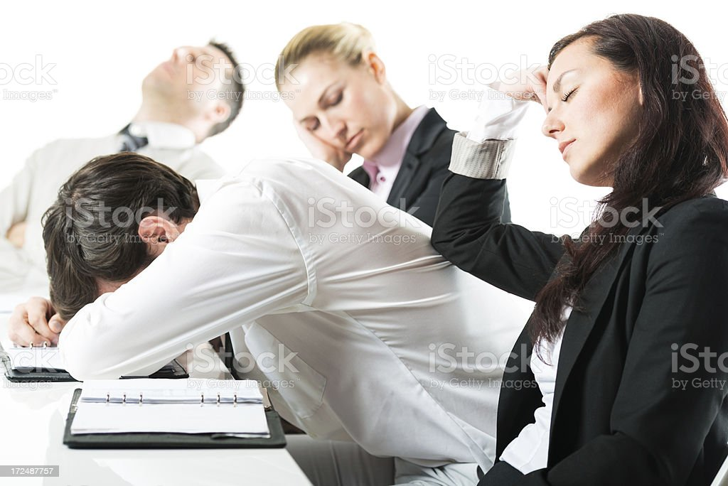 Group of business people sitting at desk looking exhausted royalty-free stock photo