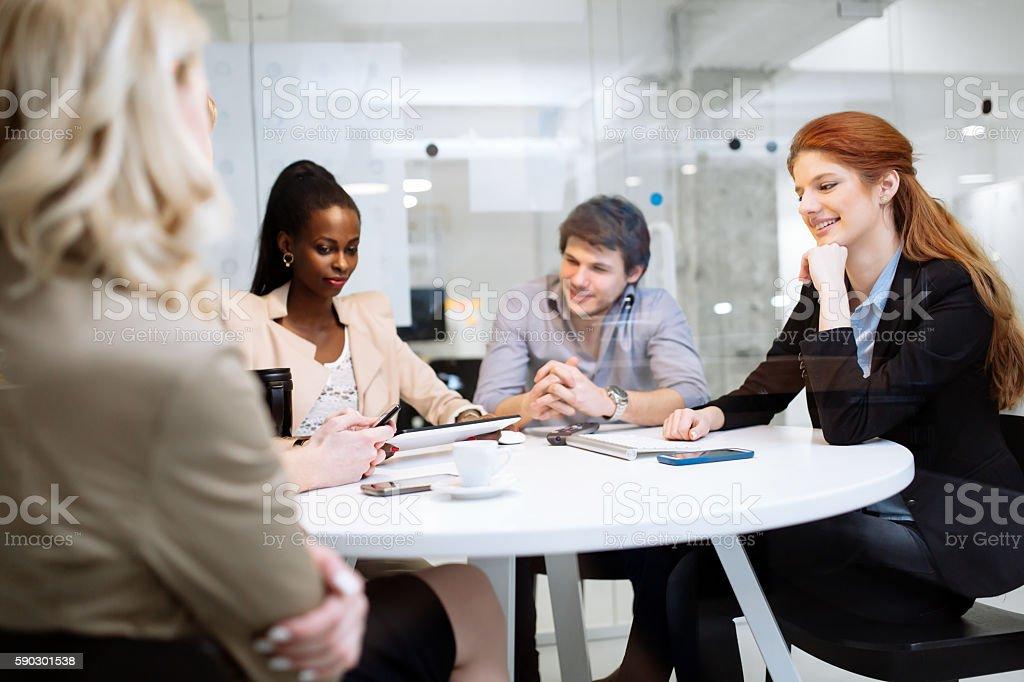 Group of business people sitting at desk royaltyfri bildbanksbilder