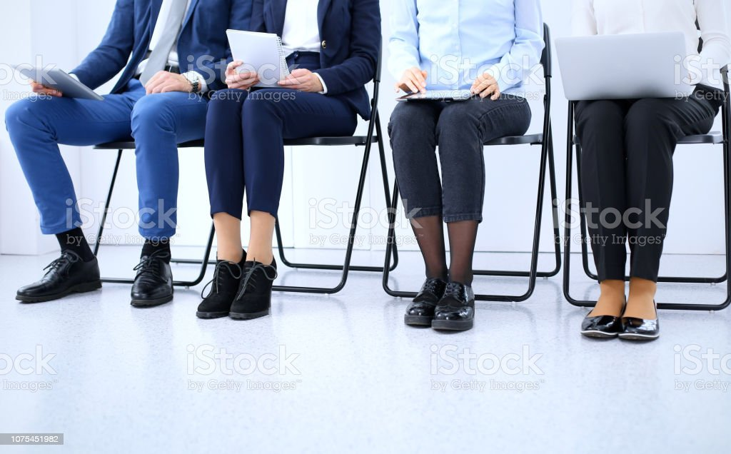 Group of business people sitting in office and waiting for job...