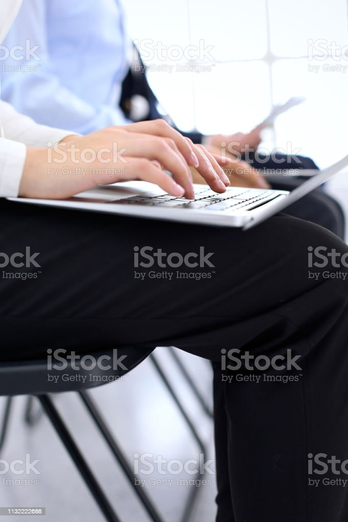 Group of business people sitting in office waiting for job interview,...