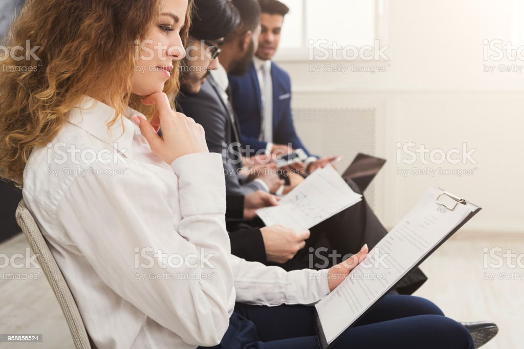 Group of business people sitting on chairs stock photo