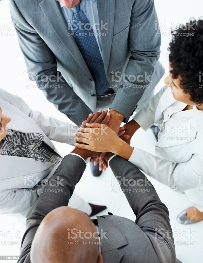 Group of business people stacking their hands together royalty-free stock photo