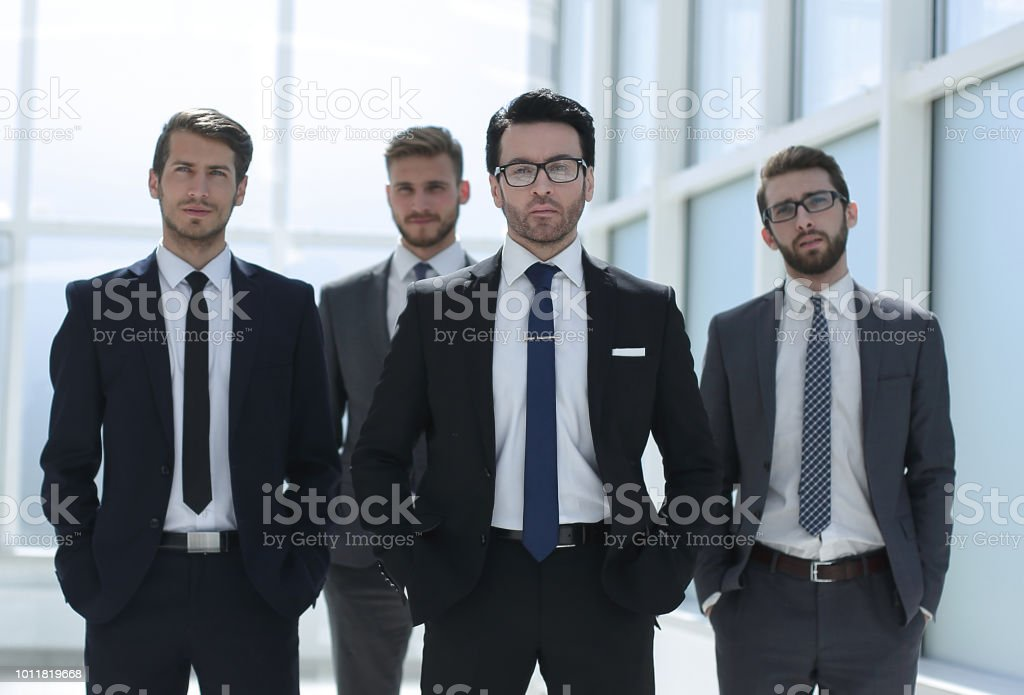 group of business people standing in the office stock photo
