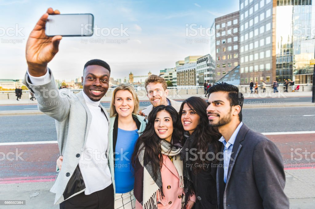 Group of business people taking a selfie in London stock photo