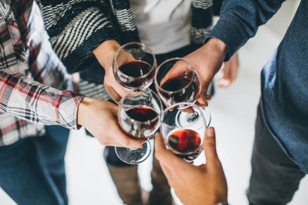 Group of business people toasting with wine stock photo