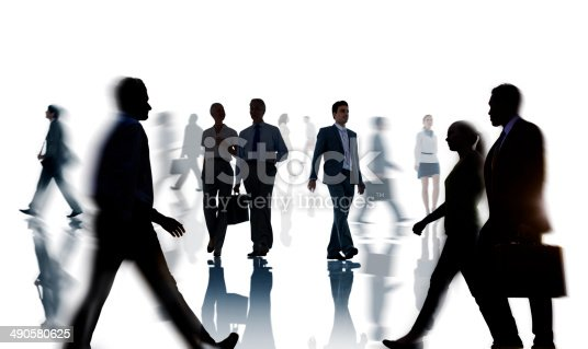 istock Group of business people walking during rush hour 490580625