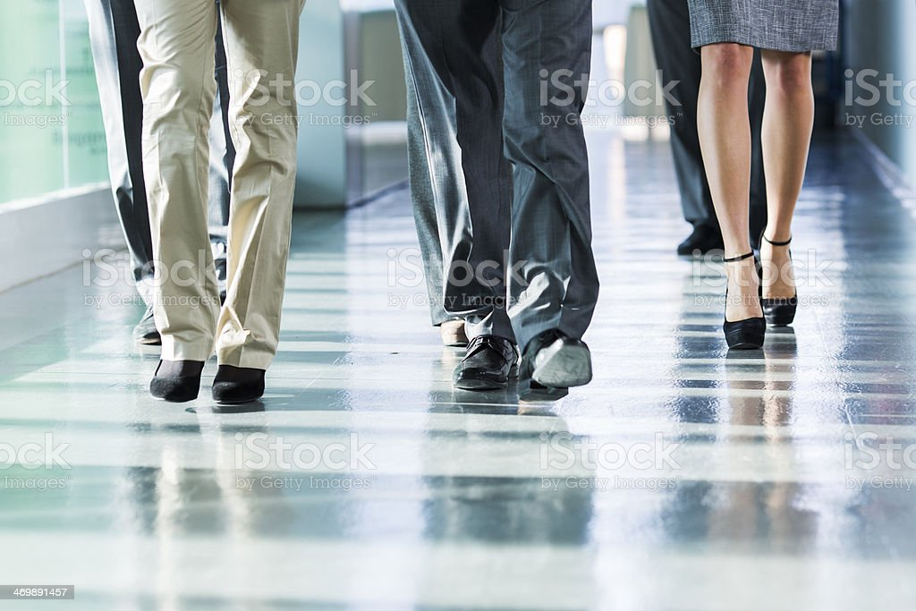 Group of business people walking on corridor stock photo