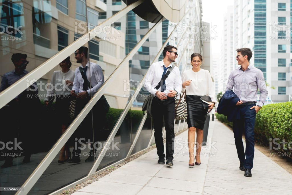 Group of business people walking talking. stock photo