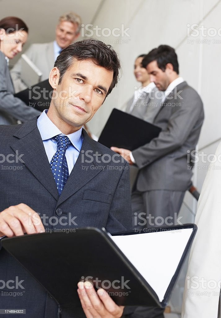 Group of business people with folders open royalty-free stock photo