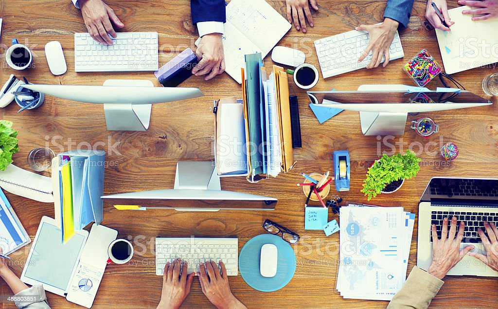 Group of Business People Working on an Office Desk stock photo